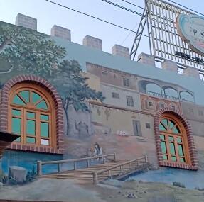 二十八盘水磨,墙上的画体现了墨玉县的母亲和喀拉喀什河沿岸人民幸福生活的场景。